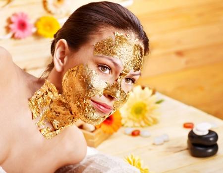gold facial: Woman getting  gold facial mask.