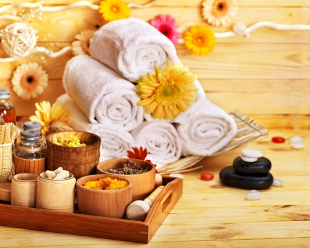 Spa still life  with towel and flower in wood spa. photo