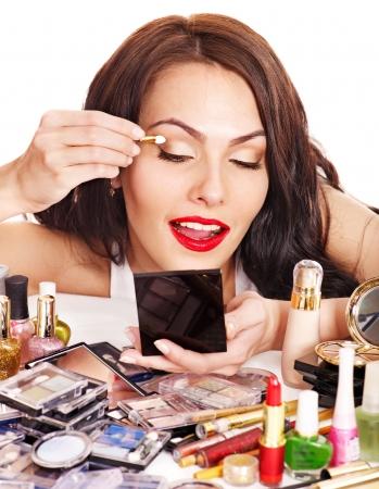 Girl holding eyeshadow and makeup brush.  Isolated. Stock Photo - 14094820