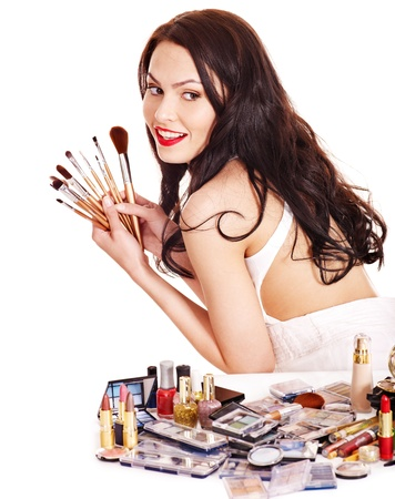 Girl holding makeup brush.  Isolated. Stock Photo - 14092457