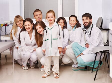 Group of doctor and child at hospital. photo