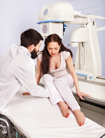 Doctor checking patient  in x-ray room. Stock Photo