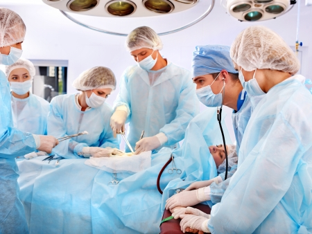 Team surgeon at work in operating room. photo