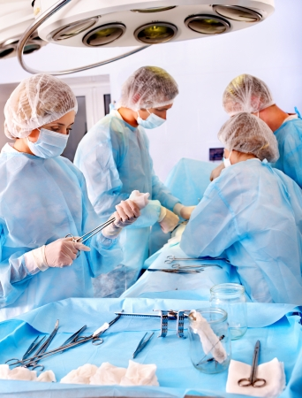 Team surgeon at work in operating room. Stock Photo - 14092480