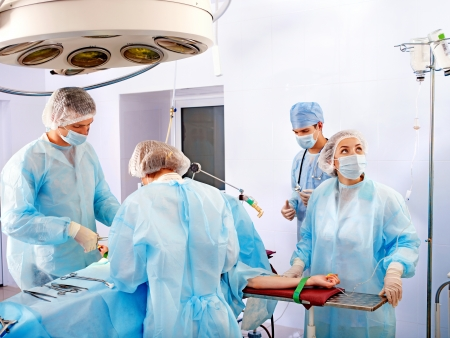 Team surgeon at work in operating room. Stock Photo - 14104814