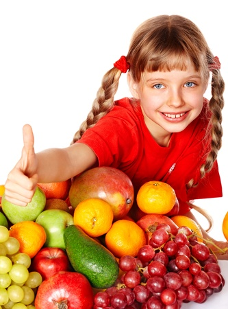bunch up: Child girl with group of  fruit. Isolated. Stock Photo