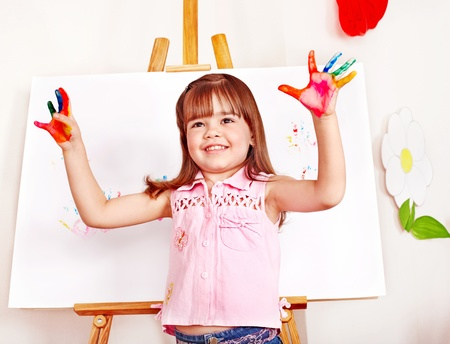 Child paint picture in preschool. Child care. photo