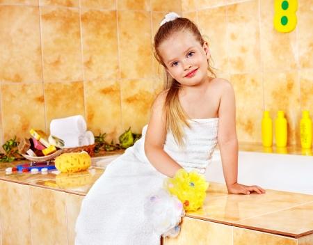 little girl bath: Happy child bathing in bubble bath .