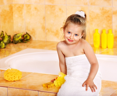 wisp: Little girl in bathroom.