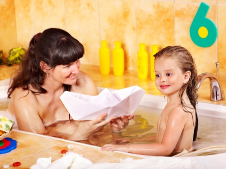 bathe: Family and child washing in bathroom . Stock Photo