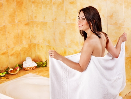 Young woman take bubble  bath. photo