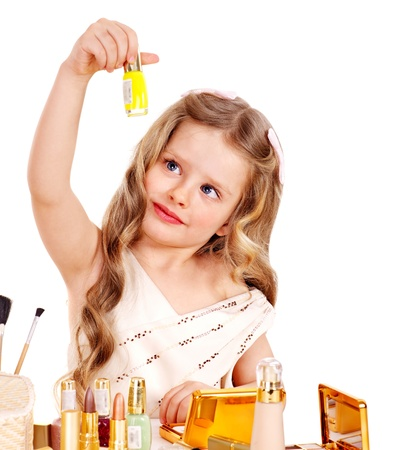 nail varnish: Child cosmetics. Little girl applying make up. Stock Photo