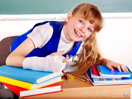 Child with broken arm in school. photo