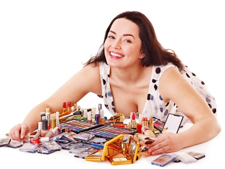 Girl applying makeup. Isolated. Stock Photo - 14529854