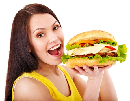 eating out: Woman holding hamburger. Isolated. Stock Photo