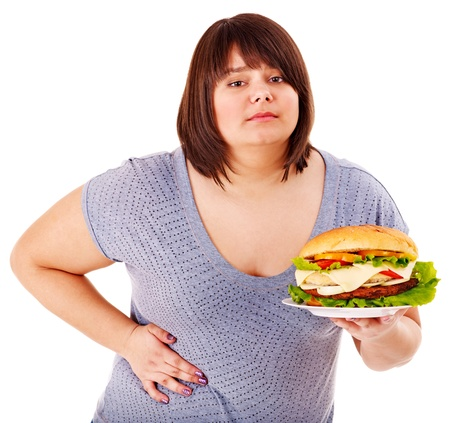 unhealthy living: Woman get abdomen pain after eating fatty food. Isolated. Stock Photo