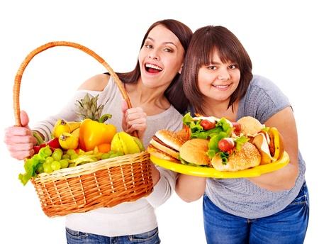 chubby: Women choosing between fruit and hamburger. Isolated.