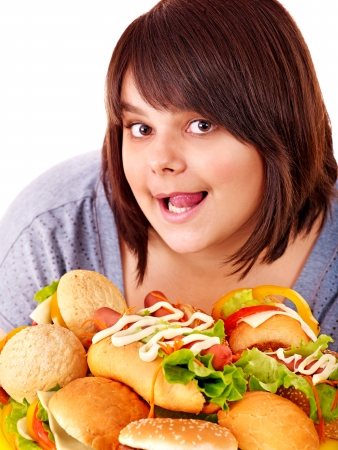 Overweight woman holding hamburger. photo