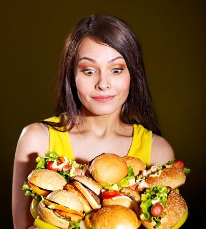Thin woman holding group hamburger. Stock Photo - 14528809