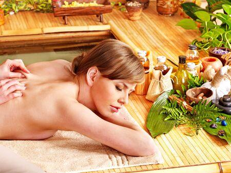 thai massage: Woman getting massage in spa near water.