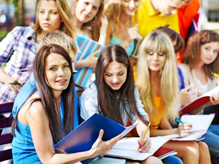 Group student with notebook on bench outdoor. Stock Photo - 14535740