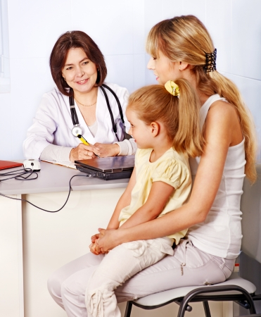 family doctor: Happy family on reception at doctor.