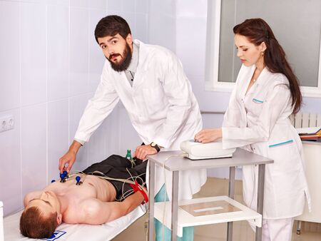 Doctor remove cardiogram test. photo
