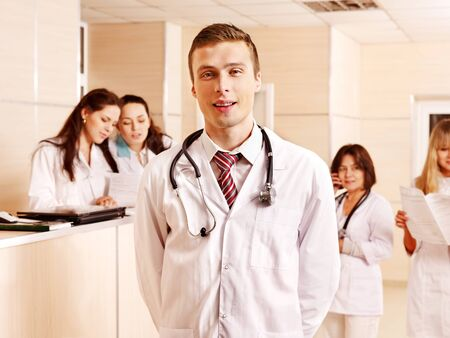 Group doctors standing at reception in hospital. Stock Photo - 14535751