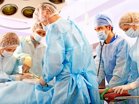 operation room: Team surgeon at work in operating room.