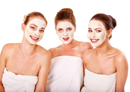 pamper: Group women with  facial mask in beauty spa.