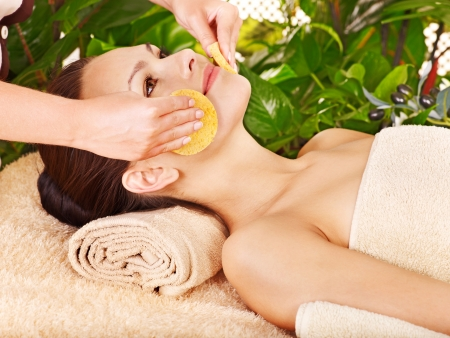 facial  spa: Woman getting facial massage in tropical beauty spa. Stock Photo