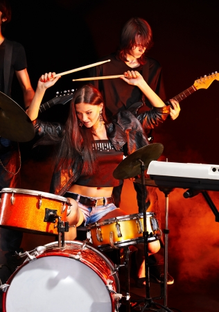 Musical group playing in night club. photo