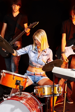 bass drum: Musical group playing in night club. Male and female. Stock Photo