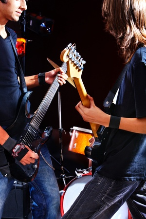 Men playing  guitar in night club. Stock Photo - 14742304