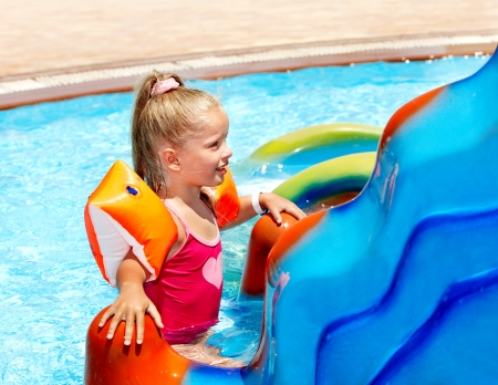 armbands: Child with armbands ride with water slides Stock Photo