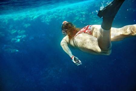 actinia: women snorkeling underwater