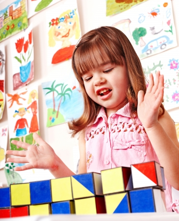 Children in kindergarten stacking block. Stock Photo - 14742023