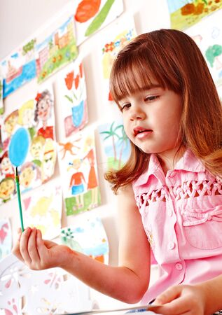 Little girl painting  in school. Stock Photo - 14742426