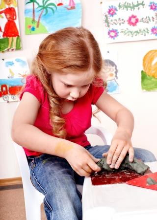 plasticine: Child playing plasticine in kindergarten. Creativity development. Stock Photo