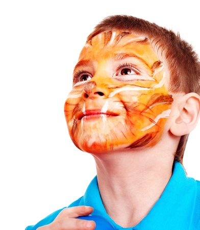 Happy little boy with paint of face. photo