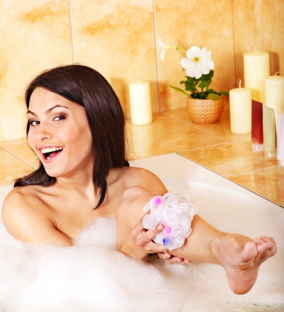 bathtubs: Young woman relaxing in bubble bath . Stock Photo