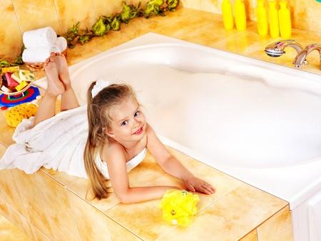 little girl bath: Little girl relaxing in bubble bath . Stock Photo