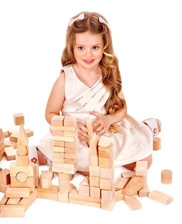 Happy child play building blocks. Isolated. photo
