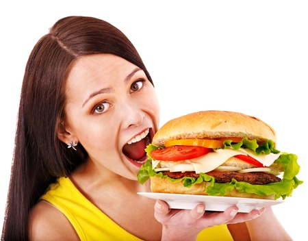 fast eat: Woman holding big hamburger. Isolated.