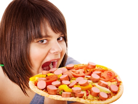 Overweight woman bite pizza. photo