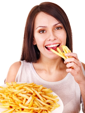 eating out: Woman eating french fries. Isolated.