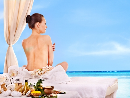 lastone therapy: Young woman getting spa lastone therapy outdoor.
