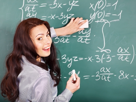 Happy schoolchild writing on blackboard. Stock Photo - 14743306