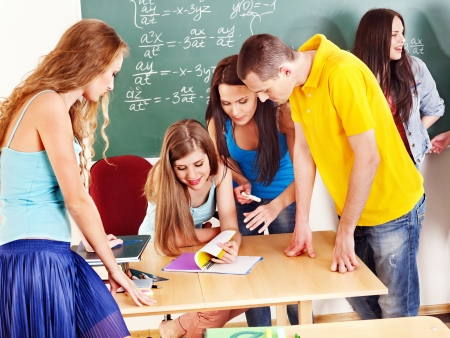 Group clever student near blackboard in classroom. Stock Photo - 14743364