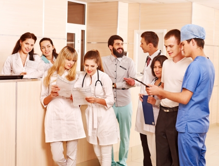 Large group doctors standing at reception in hospital. Stock Photo - 14751666